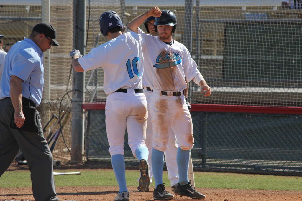 Davis Strong (left) celebrates with Chill teammate Casey Fletcher as his 2-run home run against the Power. Photo by Steve Sitter.